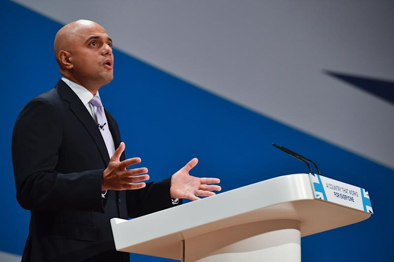 """British Communities and Local Government Secretary Sajid Javid delivers a speech on the second day of the annual Conservative Party conference at the International Convention Centre in Birmingham, central England, on October 3, 2016. Britain's economy faces """"turbulence"""" as it negotiates its EU exit and consumer and business confidence could go up and down like a """"rollercoaster"""", finance minister Philip Hammond warned on Monday ahead of a keynote speech at the ruling Conservative party's annual conference. / AFP / Ben STANSALL (Photo credit should read BEN STANSALL/AFP/Getty Images)"""