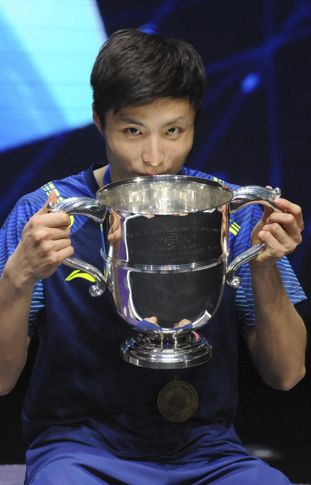 China's Shi Yuqi poses with his trophy after defeating China's Lin Dan in the men's singles final match at the All England Open Badminton tournament in Birmingham, England, Sunday March 18, 2018. (AP Photo/Rui Vieira)