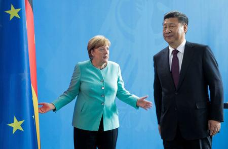 German Chancellor Angela Merkel and Chinese President Xi Jinping are seen after the news conference at the Chancellery in Berlin, Germany, July 5, 2017. REUTERS/Axel Schmidt