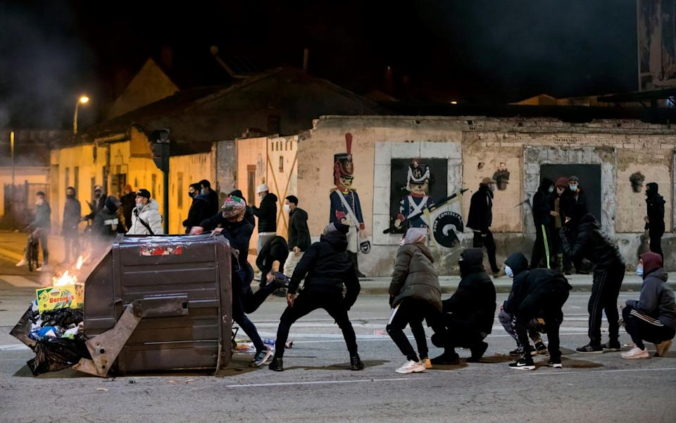 Protesters clash with police during a march against the restrictions in Burgos, Spain - Santi Otero/EPA-EFE/Shutterstock