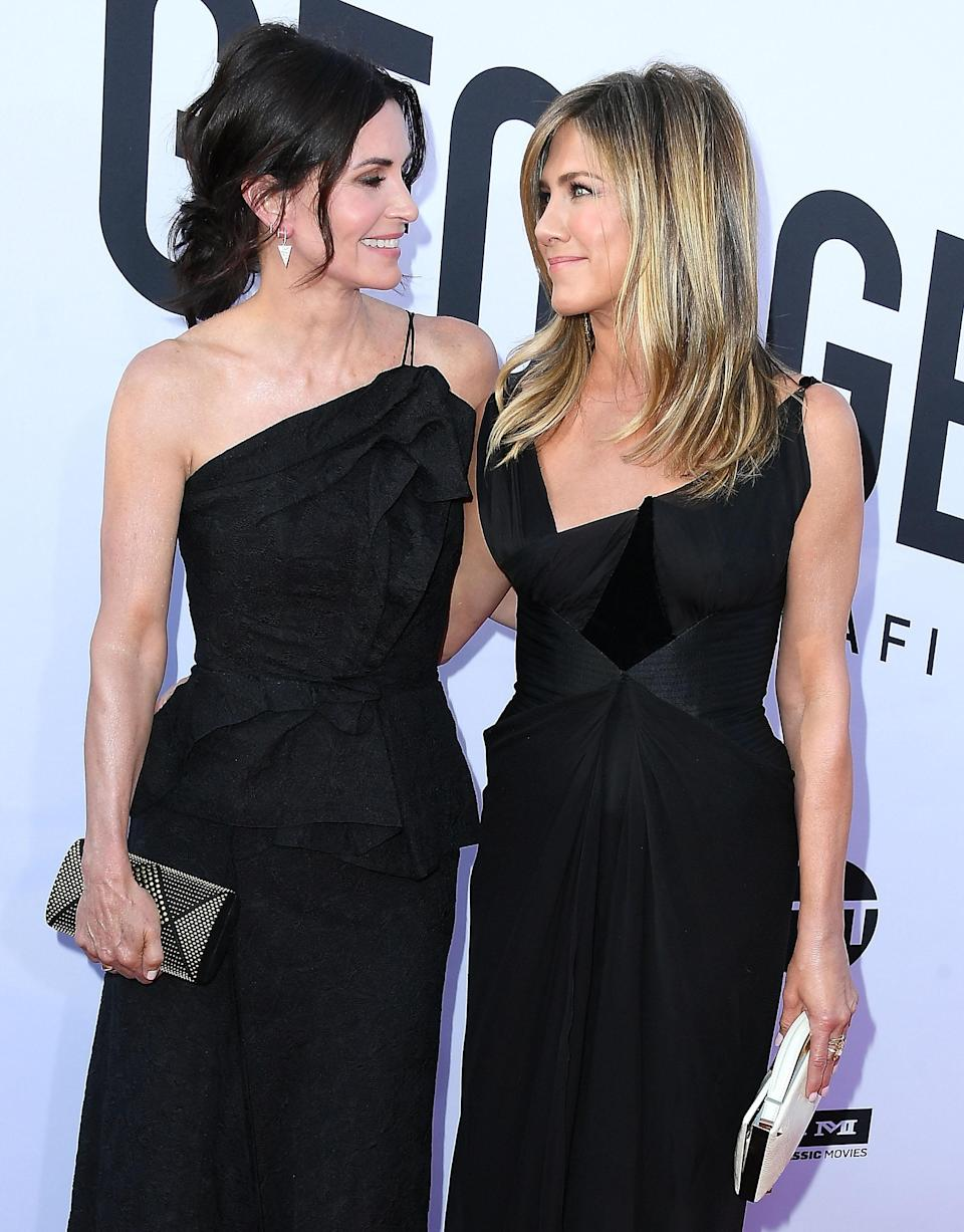 <p>Jennifer, in Christian Lacroix, and Courteney both wore asymmetric gowns for the red carpet event. <em>[Photo: Getty]</em> </p>