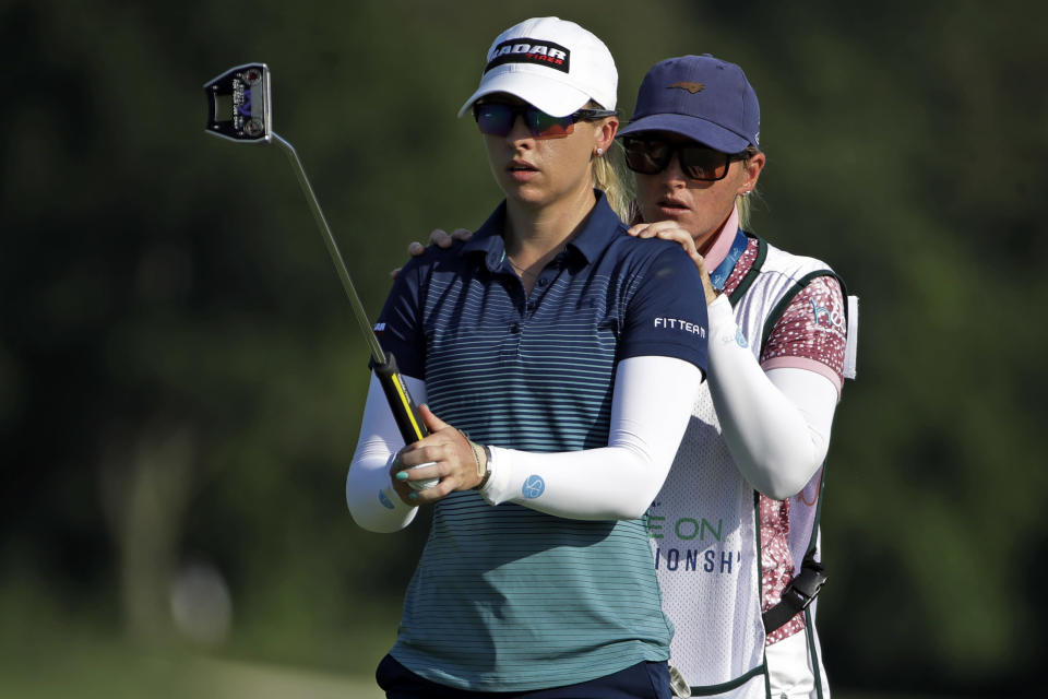 Jodi Ewart Shadoff, left, from England, gets advice from her caddie on her putt on the ninth hole during the first round of the LPGA Drive On Championship golf tournament at Inverness Golf Club in Toledo, Ohio, Friday, July 31, 2020. (AP Photo/Gene J. Puskar)