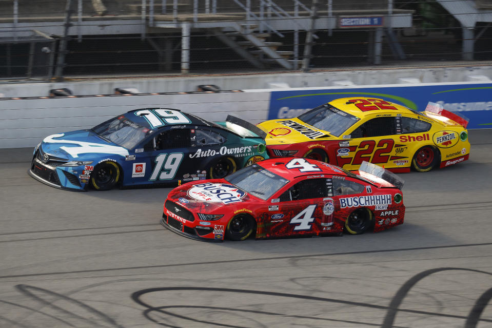 Kevin Harvick (4), Martin Truex Jr. (19) and Joey Logano (22) race during a NASCAR Cup Series auto race at Michigan International Speedway in Brooklyn, Mich., Sunday, Aug. 9, 2020. (AP Photo/Paul Sancya)