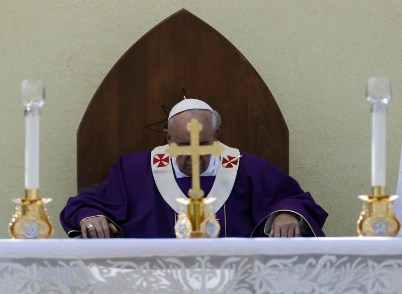 Pope Francis celebrates a mass during his visit to the island of Lampedusa, southern Italy, Monday July 8, 2013. Pope Francis traveled Monday to the tiny Sicilian island of Lampedusa to pray for migrants lost at sea, going to the farthest reaches of Italy to throw a wreath of flowers into the sea and celebrate Mass as yet another boatload of Eritrean migrants came ashore. (AP Photo/Gregorio Borgia)