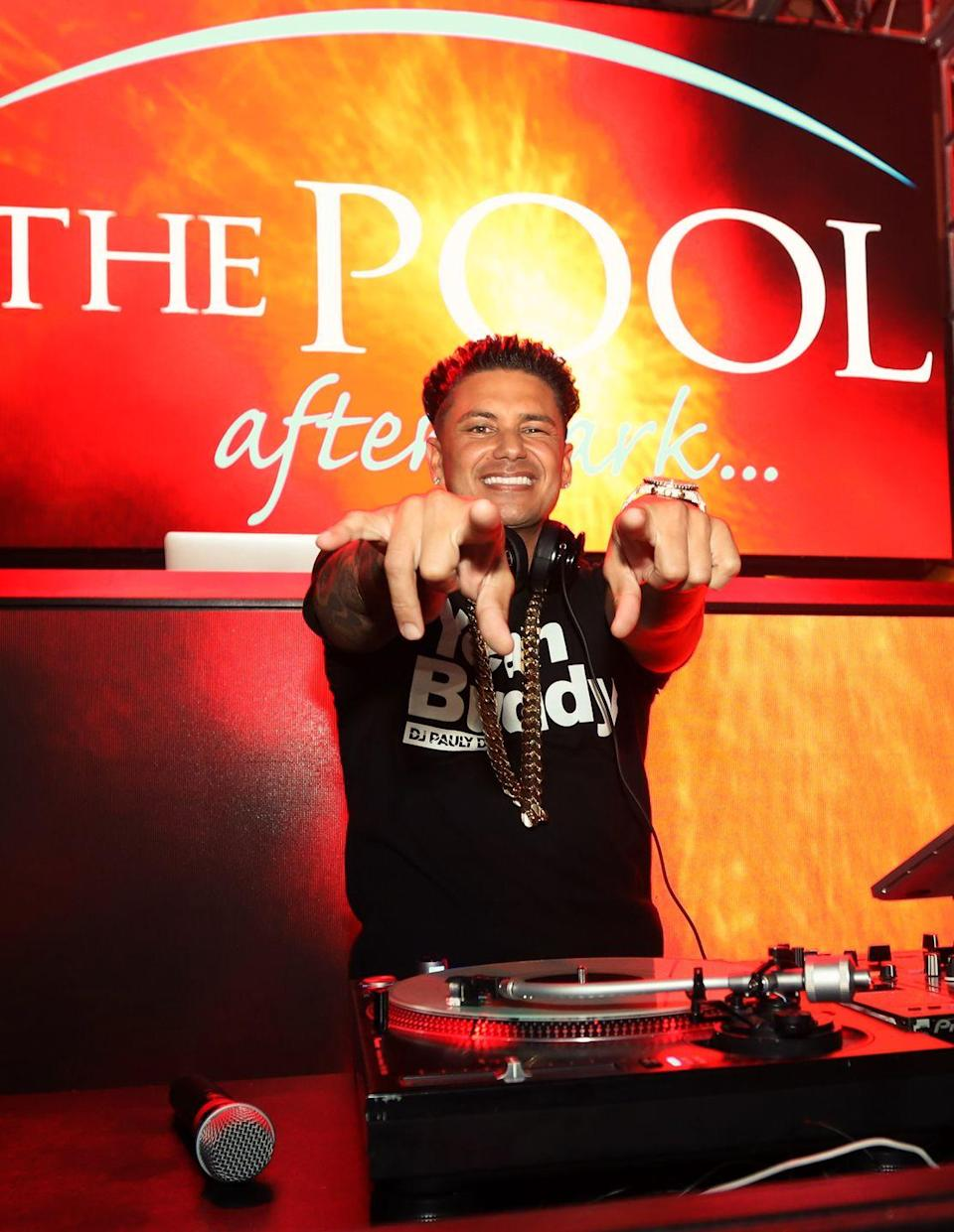 """<p>Pauly D is the richest cast member from <em>Jersey Shore </em>by far. <em><a href=""""https://www.celebritynetworth.com/richest-celebrities/richest-djs/dj-pauly-d-net-worth/"""" rel=""""nofollow noopener"""" target=""""_blank"""" data-ylk=""""slk:Celebrity Net Worth"""" class=""""link rapid-noclick-resp"""">Celebrity Net Worth</a> </em>estimates he was earning $150k per episode of the show, and is worth a whopping $20 million—in part thanks to his DJ career. According to a <a href=""""https://www.forbes.com/sites/zackomalleygreenburg/2012/08/02/gym-tan-money-inside-pauly-d-11-million-payday/#539b678050e0"""" rel=""""nofollow noopener"""" target=""""_blank"""" data-ylk=""""slk:Forbes"""" class=""""link rapid-noclick-resp""""><em>Forbes</em></a> article from 2012, Pauly D takes home an average of $40,000 per set, and he's performed at clubs, private parties, and even opened for Britney Spears. Aside from that, he's launched clothing and (naturally) tanning lotion lines, and also appeared on reality shows like <em>The Pauly D Project,</em> <em>Famously Single, </em>and <em>Double Shot at Love.</em></p>"""