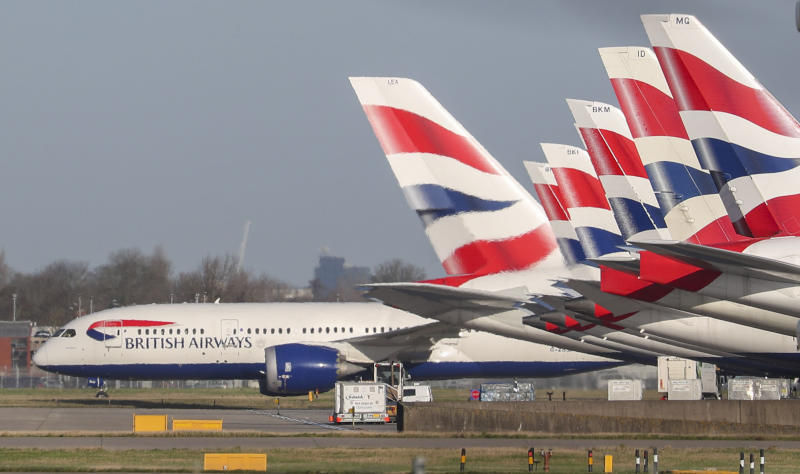 A view of British Airways planes parked at London's Heathrow Airport, Wednesday, Jan. 29, 2020. British Airways and Asian budget carriers Lion Air and Seoul Air have joined a growing list of airlines that are suspending flights to China as fears spread about the outbreak of a new virus that has killed more than 130 people. (Steve Parsons/PA via AP)