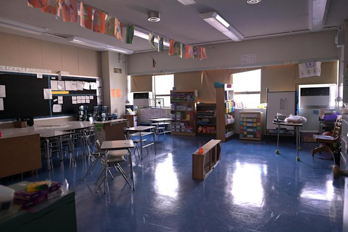 A classroom is empty with the lights off on what would otherwise be a blended learning school day on November 19, 2020 at Yung Wing School P.S. 124 in New York City. / Credit: Michael Loccisano / Getty Images