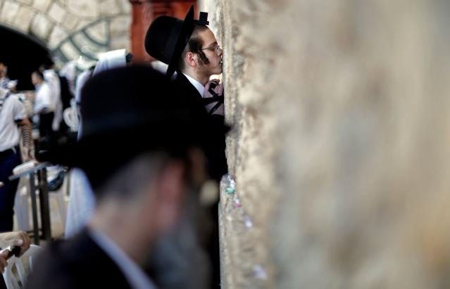 <p>Ultra-Orthodox Jewish men pray at the Western Wall in the Old City of Jerusalem on the eve of Yom Kippur also known as the Day of Atonement, the holiest day of the year in Judaism, on on Sept. 28, 2017. (Photo: Thomas Coex/AFP/Getty Images) </p>