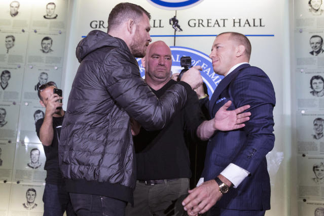 Britain's Michael Bisping (L) and Canada's Georges St-Pierre face off during a news conference. (AP)