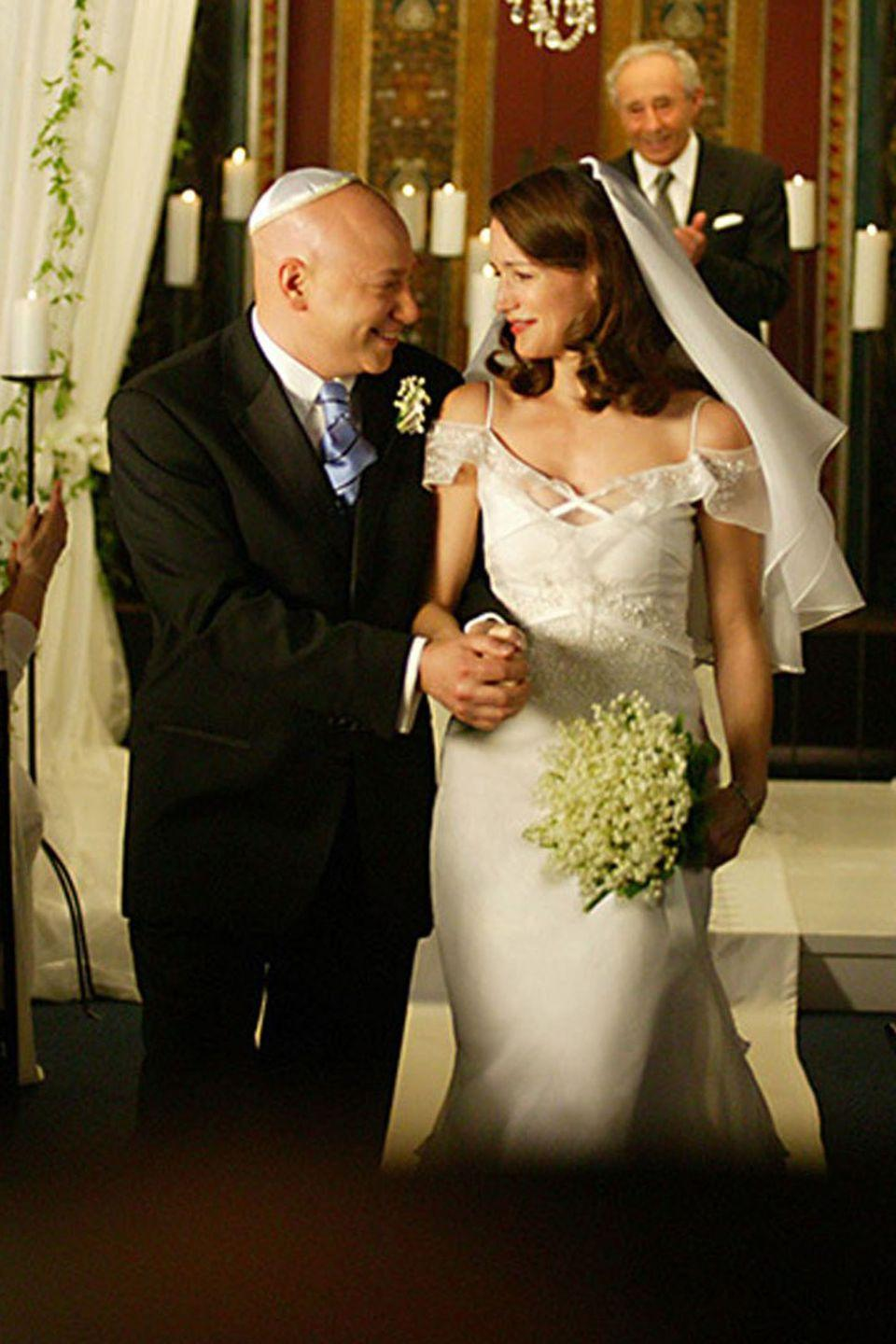 <p>In a twist of irony, in season 6<strong>, </strong>Charlotte ended up marrying Harry Goldenblatt, the lawyer who handled her divorce from her first husband, Trey MacDougal. She wore a cold-shoulder gown (very on-trend, even now) with ribbons criss-crossing the bodice. She topped the look with a veil tucked into the back of her curls. </p>