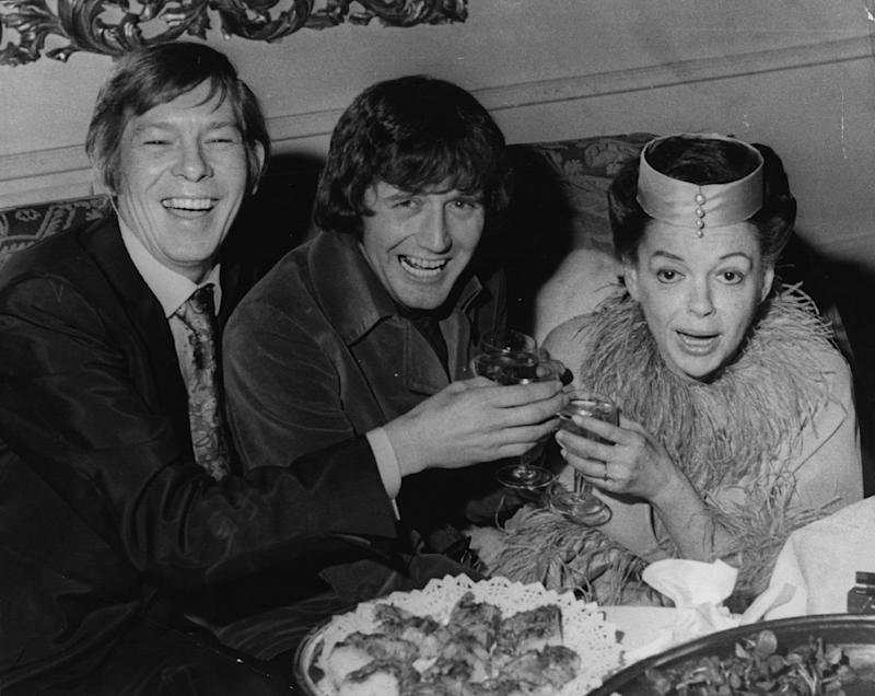 Judy Garland celebrating her wedding reception at Quaglion's with former husband Mickey Deans and Johnny Ray in 1969 (Getty Images)