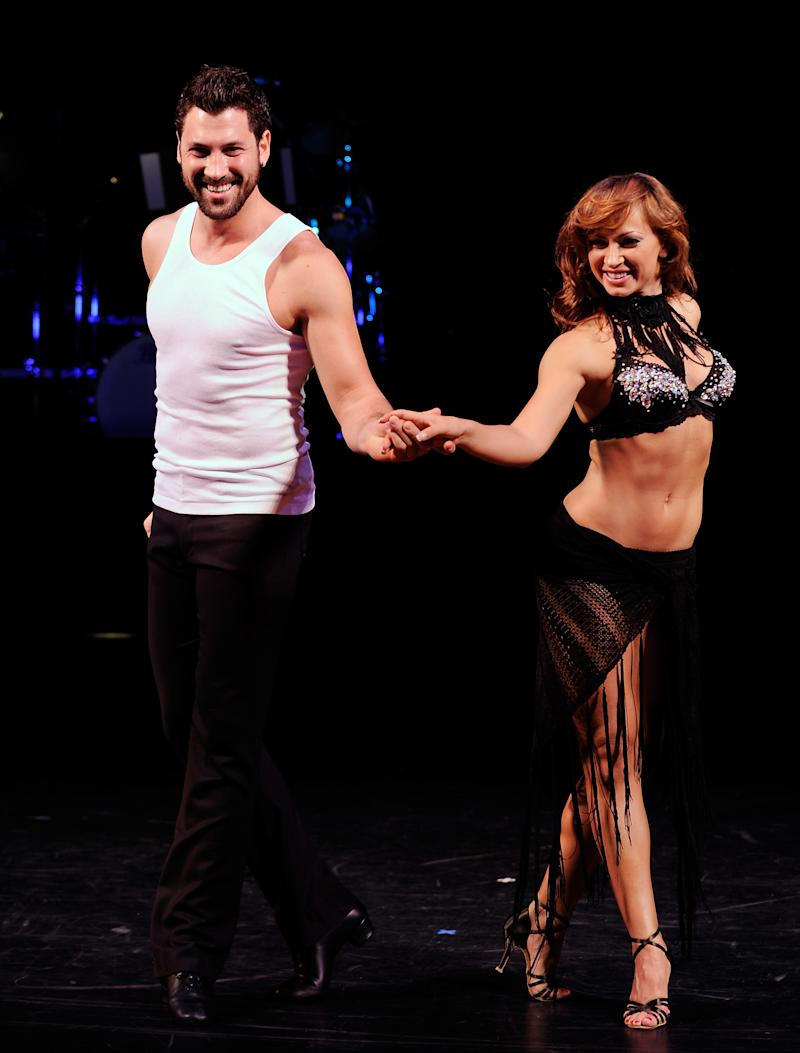 "FILE - This July 24, 2009 file photo shows dancers Karina Smirnoff, right, and Maksim Chmerkovskiy, during a press preview for the Broadway ballroom dance show ""Burn The Floor"" in New York. ""Dancing with the Stars"" duo Smirnoff and Chmerkovskiy have hopped aboard the Broadway-bound ""Forever Tango."" Producers said Wednesday, July 19, 2013, the pair will perform in the show at the Walter Kerr Theatre from July 9-28. (AP Photo/Evan Agostini, file)"