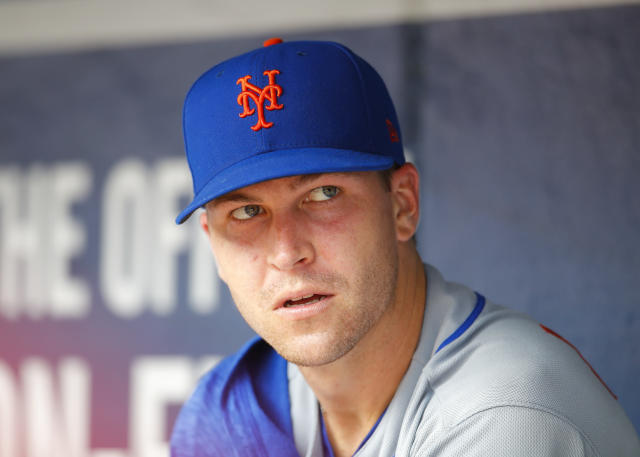 New York Mets starting pitcher Jacob deGrom watches from the dugout during the seventh inning of a baseball game against the Atlanta Braves, Wednesday, June 13, 2018, in Atlanta. The Atlanta Braves won the game 2-0. (AP Photo/Todd Kirkland)