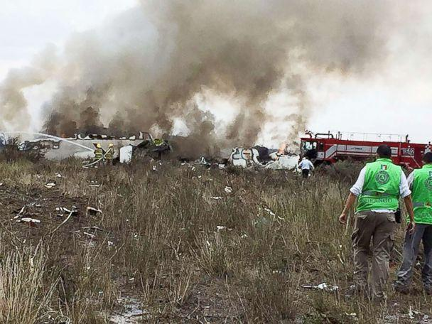 PHOTO: A handout photo made available by the Civil Protection State Coordination (CPCE) shows emergency personnel at the site where an Aeromexico plane crashed, in Durango, Mexico, July 31, 2018. (Handout/EPA via Shutterstock)