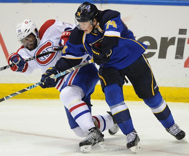 St. Louis Blues' T.J. Oahie (74) checks Montreal Canadiens' P.K. Subban during the second period of an NHL hockey game on Thursday, Dec. 19, 2013, in St. Louis. (AP Photo/Bill Boyce)