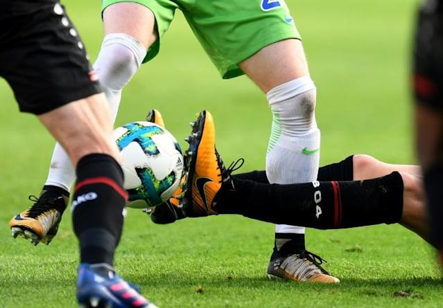 Germany's Ministry of Labour has also approved the Bundesliga's plans to resume next month. (AFP Photo/PATRIK STOLLARZ)