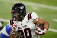 Ball State running back Tye Evans (30) rushes during the first half of the Mid-American Conference championship NCAA college football game against Buffalo, Friday, Dec. 18, 2020, in Detroit. (AP Photo/Carlos Osorio)