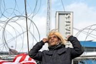 An activist impersonating US President Donald Trump demonstrates in the Mexican border city of Tijuana after Joe Biden is declared winner of the election
