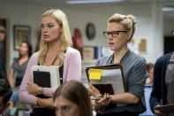 "This image released by Lionsgate shows Margot Robbie, left, and Kate McKinnon in a scene from ""Bombshell."" On Monday, Jan. 13, Robbie was nominated for an Oscar for best supporting actress for her role in the film. (Hilary B. Gayle/Lionsgate via AP)"