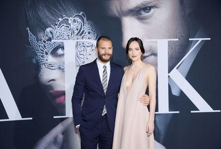 "FILE PHOTO - Jamie Dornan (L) and Dakota Johnson pose at the premiere of the film ""Fifty Shades Darker"" in Los Angeles, California, U.S. on February 2, 2017. REUTERS/Danny Moloshok/File Photo"