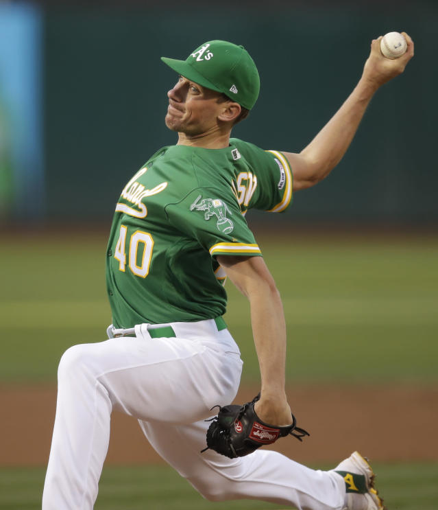 Oakland Athletics pitcher Chris Bassitt works against the Milwaukee Brewers during the first inning of a baseball game Tuesday, July 30, 2019, in Oakland, Calif. (AP Photo/Ben Margot)