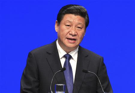 China's President Xi Jinping speaks at the College of Europe at the Concert Hall in Bruges, northern Belgium