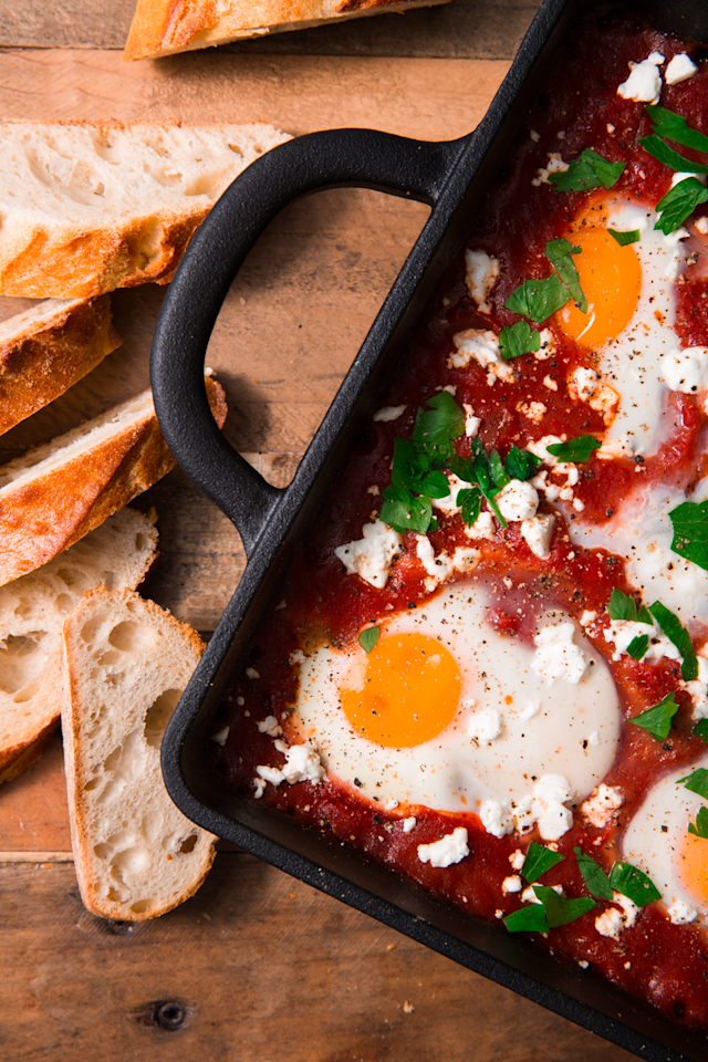 "<p>The easiest way to serve eggs to a group. </p><p>Get the recipe from <a href=""https://www.delish.com/cooking/recipe-ideas/recipes/a52277/shakshuka-with-feta-and-parsley-recipe/"" target=""_blank"">Delish</a>.</p>"