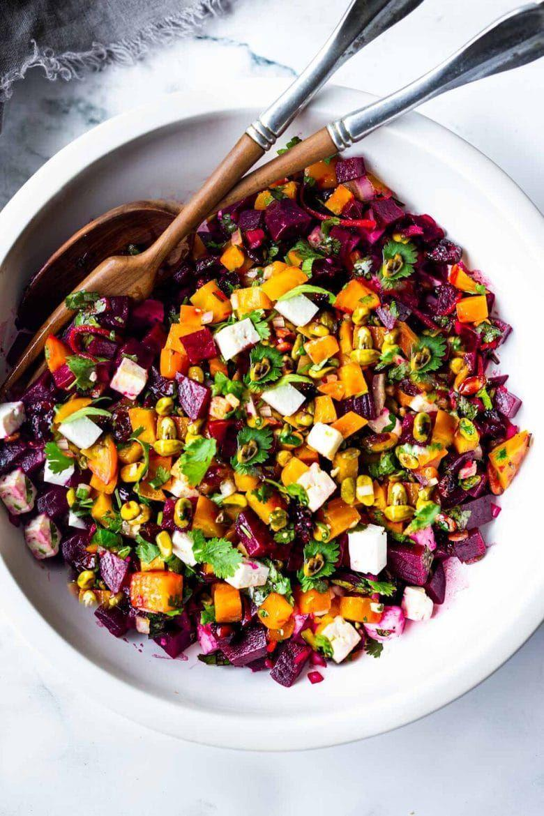 """<p>Using both red and golden beets will add a burst of color (and flavor) to your holiday table. Plus, the beets can be cooked in advance for even easier prep. </p><p><strong>Get the recipe at <a href=""""https://www.feastingathome.com/beet-salad-with-feta/"""" rel=""""nofollow noopener"""" target=""""_blank"""" data-ylk=""""slk:Feasting at Home"""" class=""""link rapid-noclick-resp"""">Feasting at Home</a>.</strong></p>"""