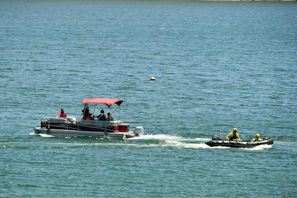 """PIRU, CALIFORNIA - JULY 09:  Boats with emergency workers search Lake Piru, where actress Naya Rivera was reported missing Wednesday, on July 9, 2020 in Piru, California. Rivera, known for her role in """"Glee,"""" was reported missing July 8 after her four-year-old son, Josey, was found alone in a boat rented by Rivera. The Ventura County Sheriff's Department is coordinating a search and recovery operation. (Photo by Amy Sussman/Getty Images)"""