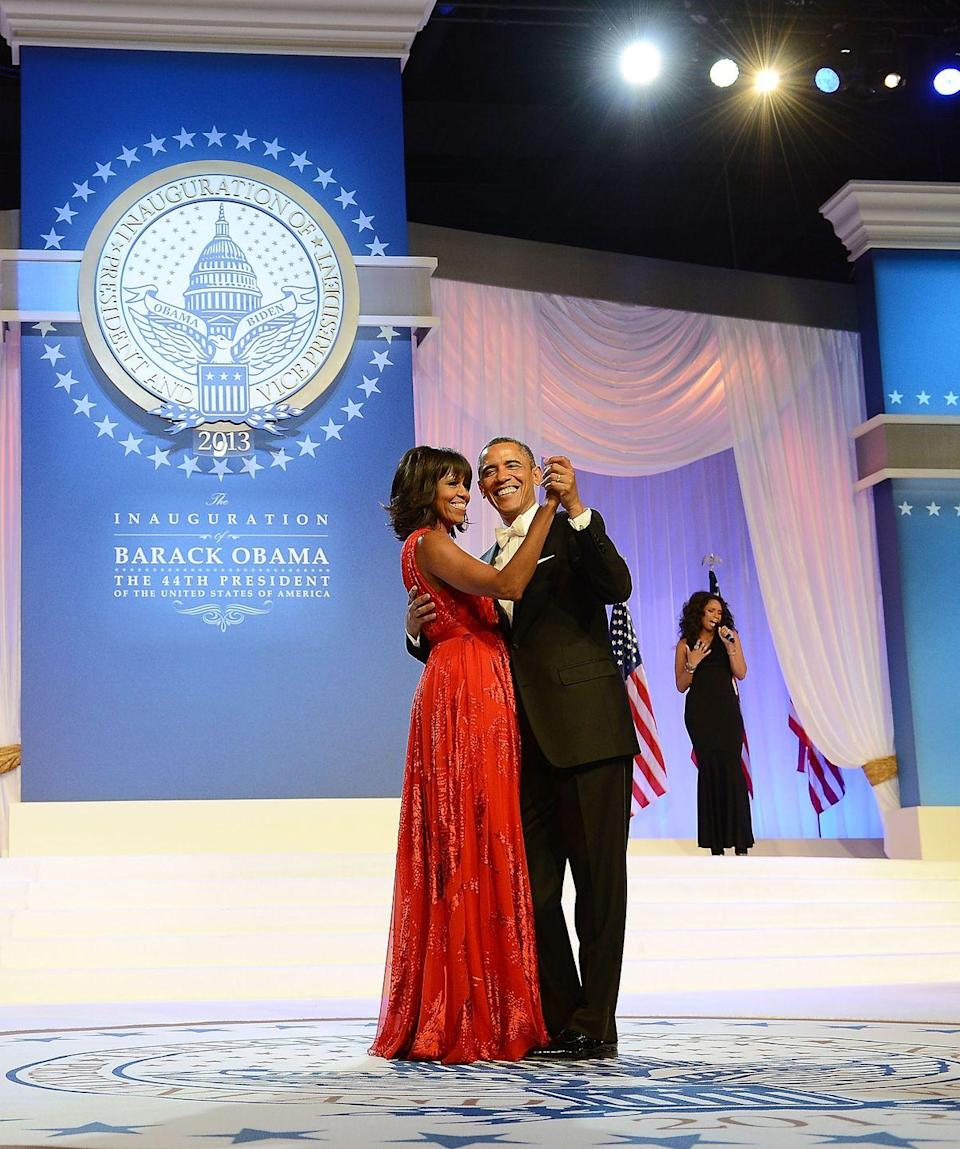 <p>The Obamas celebrate another Presidential term in the White House with a dance at Barack's second inaugural ball. The First Lady, again wearing Jason Wu, looked sensational in a chiffon and velvet red evening gown. </p>