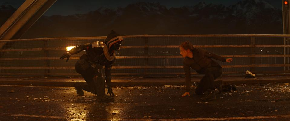 "Natasha Romanoff (Scarlett Johansson, right) battles the mysterious Taskmaster, who can mimic an opponent's fighting style in the Marvel superhero film ""Black Widow."""