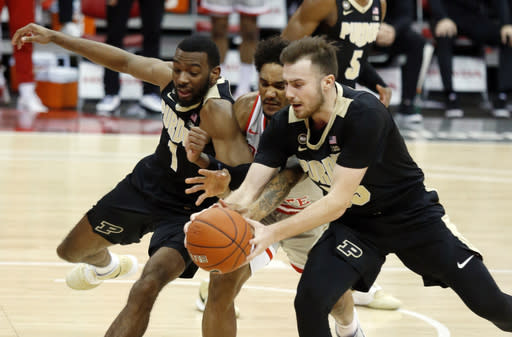 Purdue forward Aaron Wheeler, left, and guard Sasha Stefanovic, right, reach for a loose ball against Ohio State guard Musa Jallow, center, during the second half of an NCAA college basketball game in Columbus, Ohio, Tuesday, Jan. 19, 2021. (AP Photo/Paul Vernon)