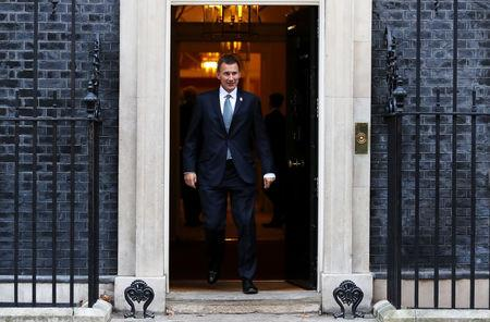 Britain's Foreign Secretary Jeremy Hunt leaves 10 Downing Street, London