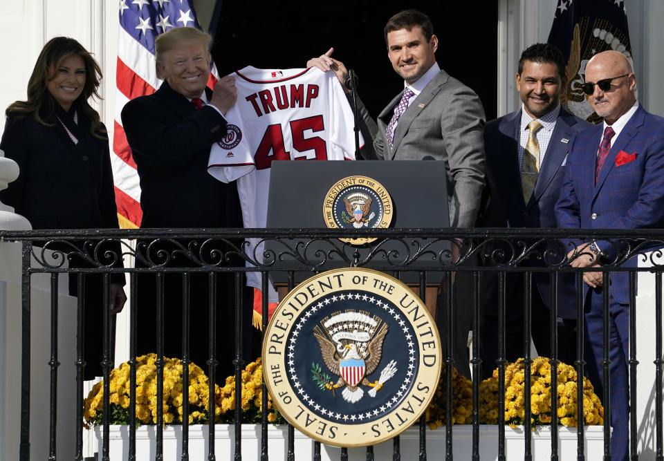 President Trump holds up a jersey from the Washington Nationals. (Getty)