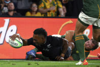 New Zealand's Sevu Reece, left, scores a try as South Africa's Duane Vermeulen is unable to stop him during their Rugby Championship test match on the Gold Coast, Australia, Saturday, Oct. 2, 2021. (AP Photo/Tertius Pickard)