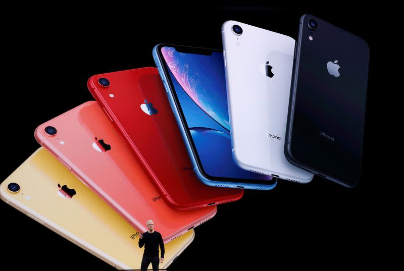FILE PHOTO: CEO Tim Cook presents the new iPhone 11 at an Apple event at their headquarters in Cupertino, U.S.