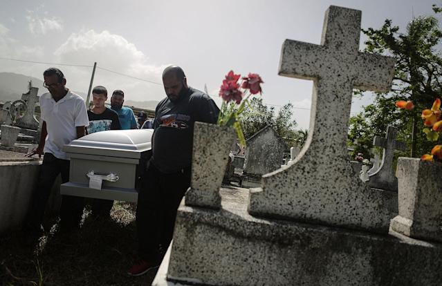 <p>Mourners carry the casket of Wilfredo Torres Rivera, 58, who died Oct. 13 after jumping off a bridge into a lake, three weeks after Hurricane Maria, on Oct. 19, 2017 in Utuado, Puerto Rico. Utuado was one of the hardest hit areas on the island and remains largely without grid electricity or running water. Wilfredo's family said he suffered from depression and schizophrenia and was caring for his 92-year-old mother in a home without electricity or water in the aftermath of Maria. They believe he did not have the mental tools to manage the challenges of the storm's aftermath. The family was concerned and brought Wilfredo to a doctor shortly before his death but they say he was not provided with adequate care or counseling. While the government has ruled his death a suicide, the family believes his death should be classified as a death caused by Hurricane Maria. (Photo: Mario Tama/Getty Images) </p>