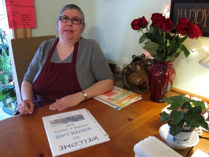 In this photo taken May 15, 2012, in Hope, Alaska, Cherryl Stavish poses at her Winter Cafe restaurant. Stavish works Saturdays at the Hope Post Office, and says if the U.S. Postal Service follows through on its plan to cut the rural Alaska post office's hours by 50 percent, she will lose her job there. (AP Photo/Mark Thiessen)