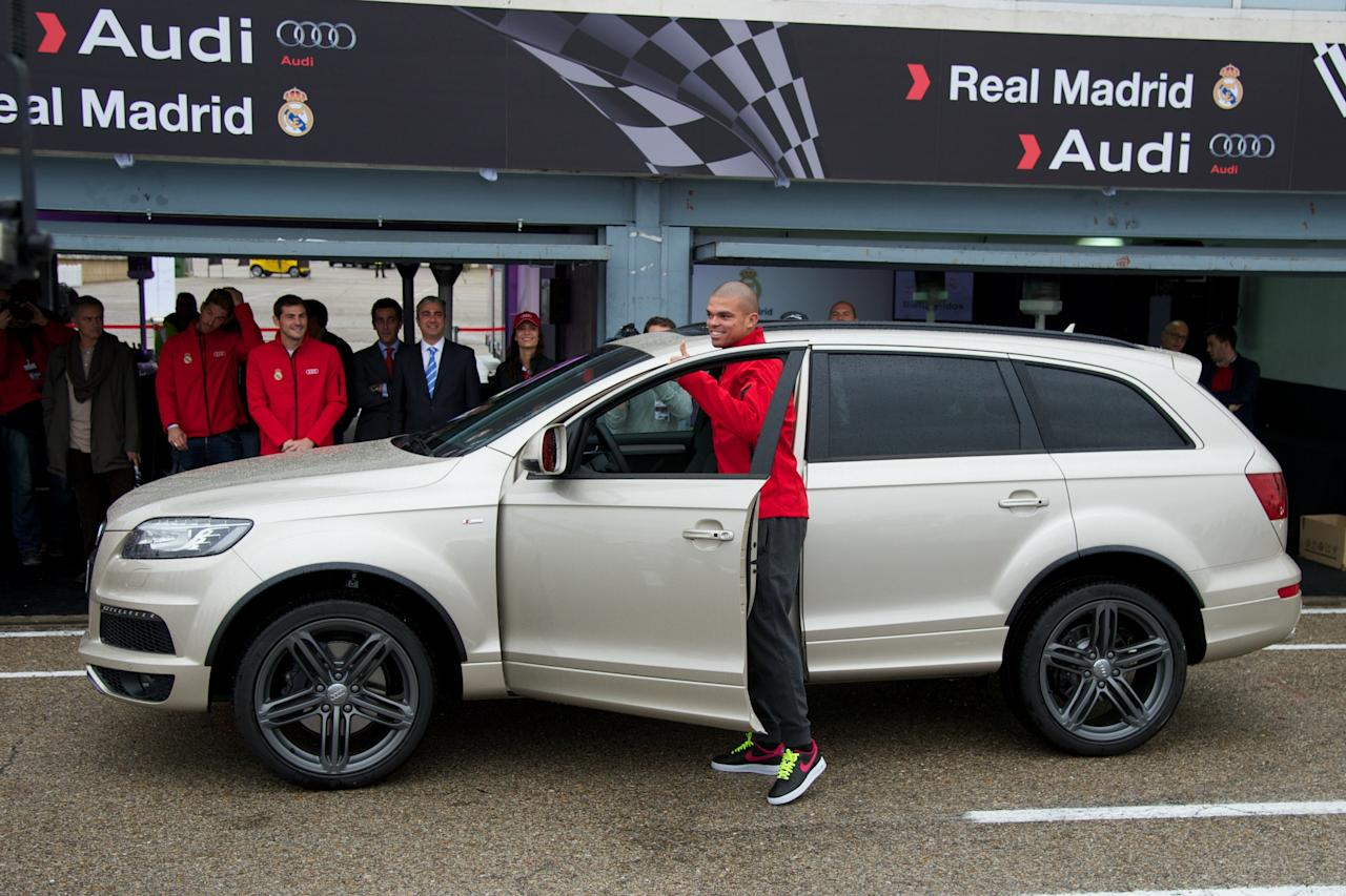 MADRID, SPAIN - NOVEMBER 08:  Real Madrid player Pepe receives a new Audi Q7 at the Jarama racetrack on November 8, 2012 in Madrid, Spain.  (Photo by Carlos Alvarez/Getty Images)