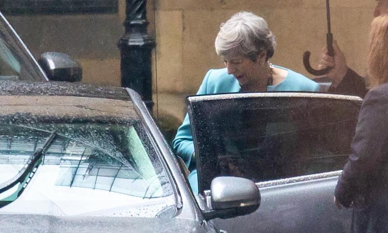 Theresa May leaves the Houses of Parliament on Wednesday.