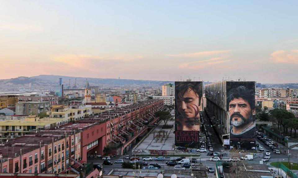 A mural of Diego Maradona, right, in Naples