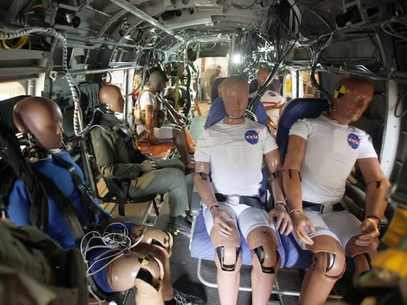 The dummies will test seatbelts and other technologies during a crash test in which the helicopter will be dropped from a height of about 30 feet.
