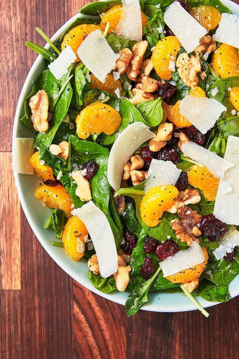 """<p>When it comes to <a href=""""https://www.delish.com/uk/cooking/recipes/g29830208/healthy-salad-recipes/"""" rel=""""nofollow noopener"""" target=""""_blank"""" data-ylk=""""slk:summer salads"""" class=""""link rapid-noclick-resp"""">summer salads</a>, this one takes the cake. The mandarin oranges give it a burst of freshness while the Parmesan gives it a bite of sharpness and nuttiness. Its homemade poppy seed vinaigrette (super-simple!) is unbelievably addicting and takes this salad to the next level. Keep the extra vinaigrette in the fridge and use it on everything! Add some <a href=""""https://www.delish.com/uk/cooking/recipes/a28841199/best-grilled-chicken-breast-recipe/"""" rel=""""nofollow noopener"""" target=""""_blank"""" data-ylk=""""slk:simple grilled chicken"""" class=""""link rapid-noclick-resp"""">simple grilled chicken</a> to turn this salad into a meal.</p><p>Get the <a href=""""https://www.delish.com/uk/cooking/recipes/a32846762/mandarin-orange-salad-recipe/"""" rel=""""nofollow noopener"""" target=""""_blank"""" data-ylk=""""slk:Mandarin Orange Salad"""" class=""""link rapid-noclick-resp"""">Mandarin Orange Salad</a> recipe.</p>"""