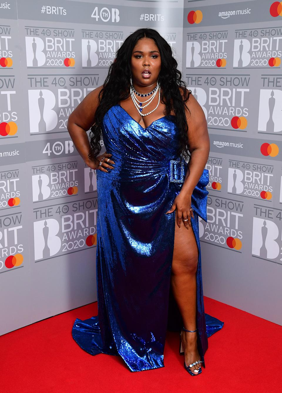 Not to be outdone by her first look, Lizzo also wowed fans at the BRIT Awards Pressroom with a sparkly blue gown from the Dundas Spring 2020 collection.
