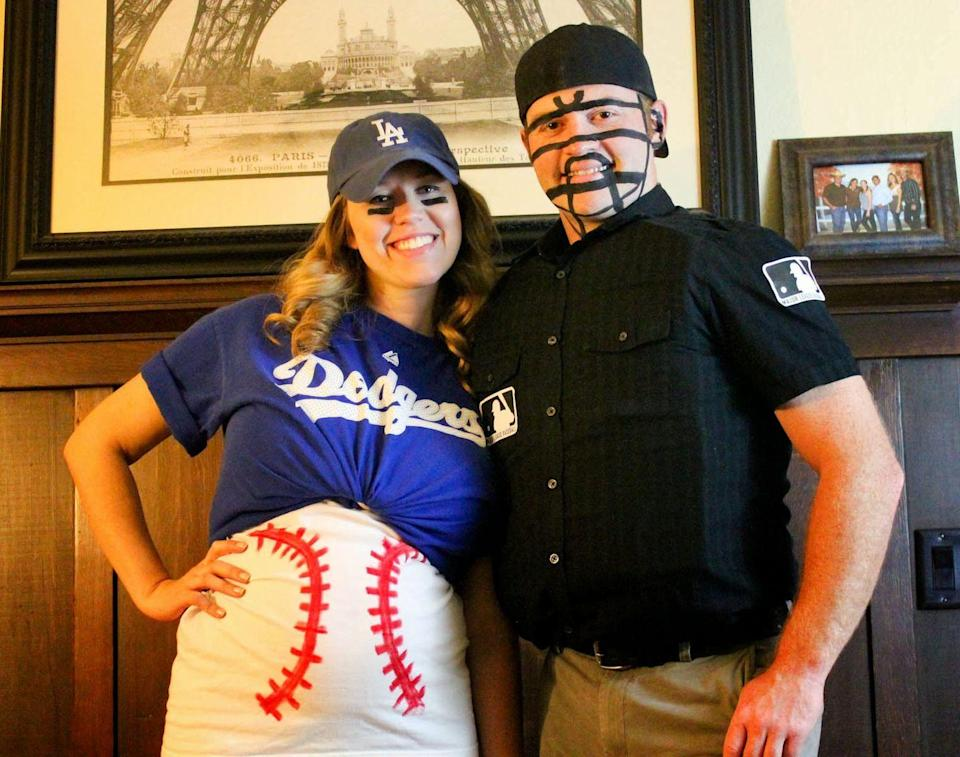 """<p>For a costume that really knocks it out of the park, turn your belly into a baseball and have your SO dress up as an umpire. </p><p><strong><strong><em><a href=""""http://fromdahliastodoxies.blogspot.com/2013/10/diy-pregnant-baseball-and-umpire.html"""" rel=""""nofollow noopener"""" target=""""_blank"""" data-ylk=""""slk:Get the tutorial at From Dahlias to Doxies"""" class=""""link rapid-noclick-resp"""">Get the tutorial at From Dahlias to Doxies</a>.</em></strong></strong></p><p><strong><a class=""""link rapid-noclick-resp"""" href=""""https://www.amazon.com/Majestic-Angels-Dodgers-T-Shirt-Royal/dp/B073V4QMSW?tag=syn-yahoo-20&ascsubtag=%5Bartid%7C10070.g.28589425%5Bsrc%7Cyahoo-us"""" rel=""""nofollow noopener"""" target=""""_blank"""" data-ylk=""""slk:SHOP BASEBALL SHIRT"""">SHOP BASEBALL SHIRT</a></strong></p>"""