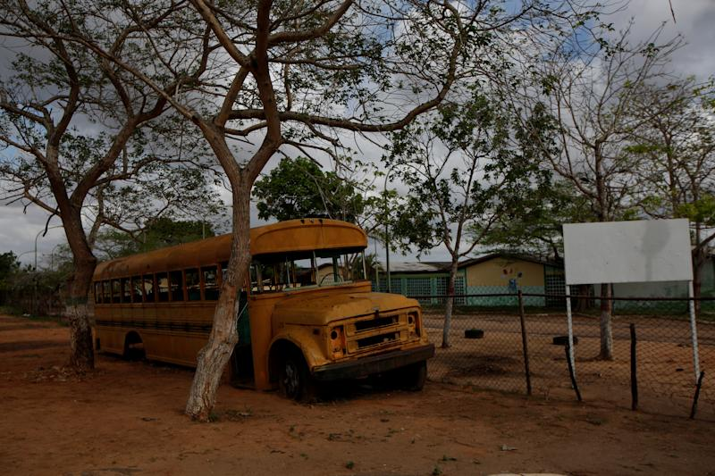 An out-of-service school bus remains near a school on the outskirts at El Tigre, Venezuela, on June 4. (Photo: Ivan Alvarado/Reuters)