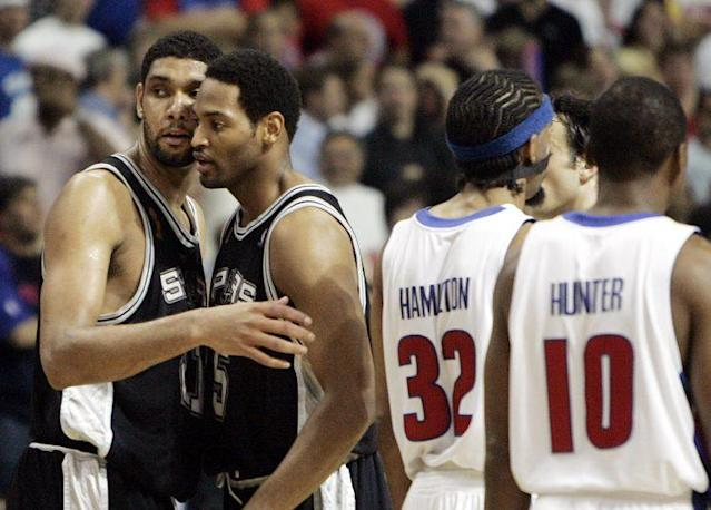 Tim Duncan and Robert Horry in friendlier times. (AP)