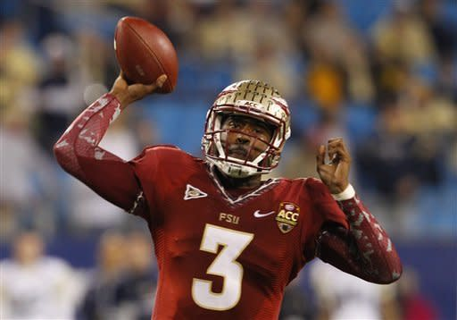 Florida State's EJ Manuel (3) throws a pass against Georgia Tech during the first half of the ACC Championship college football game in Charlotte, N.C., Saturday, Dec. 1, 2012. (AP Photo/Chuck Burton)