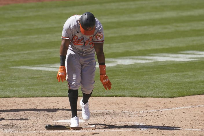 Baltimore Orioles' Maikel Franco throws down his bat after striking out against the Oakland Athletics during the seventh inning of a baseball game in Oakland, Calif., Sunday, May 2, 2021. (AP Photo/Jeff Chiu)