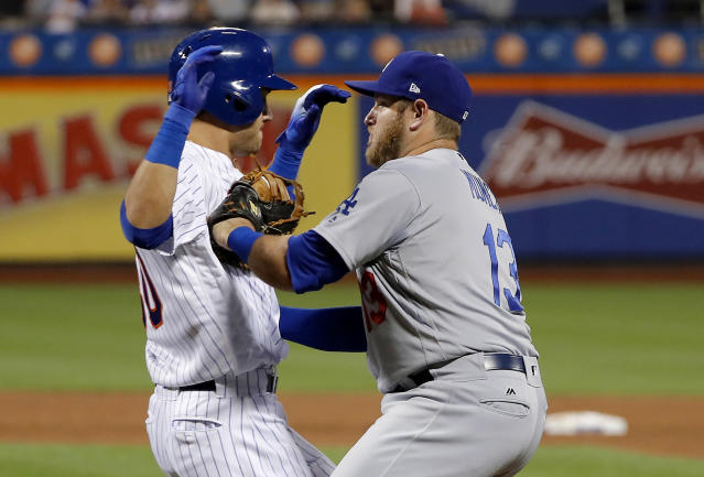 Los Angeles Dodgers first baseman Max Muncy (13) tags out New York Mets' Michael Conforto to end the fifth inning on Conforto's ground ball up the first-base line during a baseball game Saturday, June 23, 2018, in New York. (AP Photo/Julie Jacobson)
